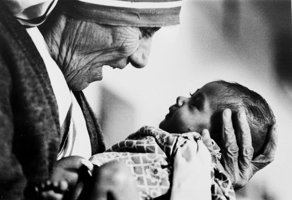 FILE - In this 1978, file photo, Mother Teresa, head of the Missionaries of Charity order, cradles an armless baby girl at her order's orphanage in what was then known as Calcutta, India, in 1978. Pope Francis has signed off on the miracle needed to make Mother Teresa a saint, giving the nun who cared for the poorest of the poor one of the Catholic Church's highest honors just two decades after her death. The Vatican said Friday, Dec. 18, 2015, that Francis approved a decree attributing a miracle to Mother Teresa's intercession during an audience with the head of the Vatican's saint-making office on Thursday, his 79th birthday. (AP Photo/Eddie Adams, File)